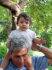 An Indian man with blue eyes and his grand son also with blue eyes